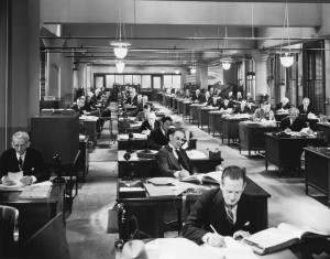 People working in an old office design