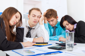 People falling asleep during a business meeting