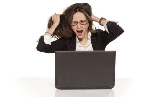 A woman looking at negative online employer reviews