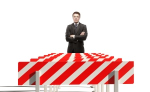 A man stands in front of hurdles symbolizing a complex job application