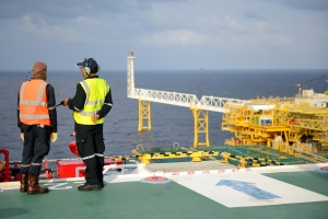 Two men on an offshore oil rig