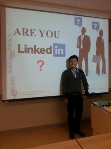 Johnny Wu stands in front of his presentation about LinkedIn