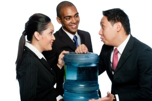 Employees gossiping at the water cooler