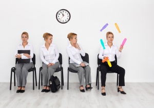 A woman juggles while her clones sit and stare because how to find a job means standing out