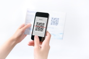 A manager scans a QR code on a resume because how to find a job involves creative thinking