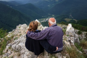 An older couple on a mountain top