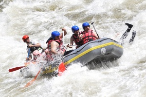 Coworkers struggle in a whitewater raft