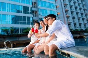 Coworkers enjoy a summer poolside networking event