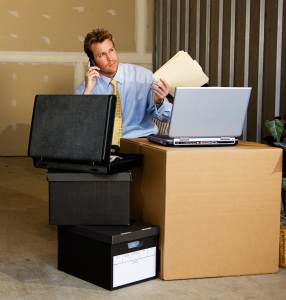 A temp professional from an employment agency works at a temporary desk