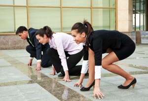 Workers line up to race representing how to motivate employees