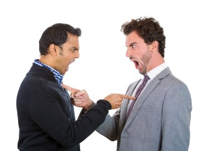 Two coworkers fighting because of blame for making mistakes at work