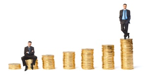 Two men on two piles of coins indicating different job market value