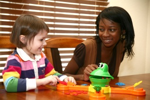 A young woman babysits as an example of jobs for students