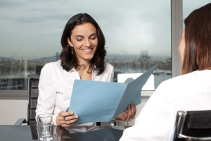 A woman is pleased with her efforts in performance management with an employee