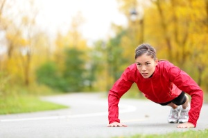 A woman exercises in autumn to increase her productivity