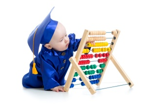 A baby at an abacus. Accounting is still the foundation for a comptroller.