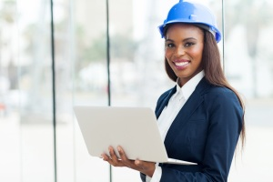 A woman engineer smiles. The importance of soft skills in technical fields are leveraged to draw women.