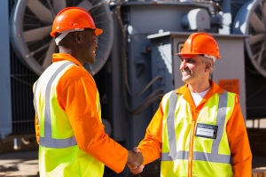 Two engineers shake hands because soft skills like amicability are important in the technical fields