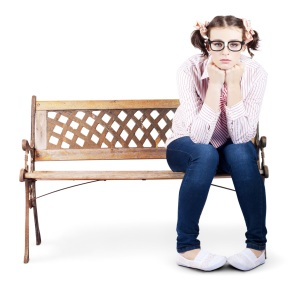 A dyspeptic girl sits on a bench. Soft skill aren't as elusive to technical people as is often thought.