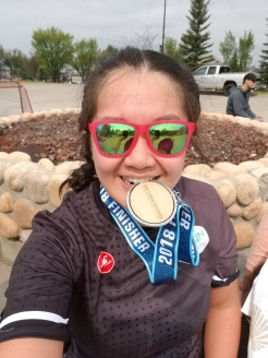 Anne after competing in her first Sprint Distance Triathlon in Calgary, AB on August 12, 2018.