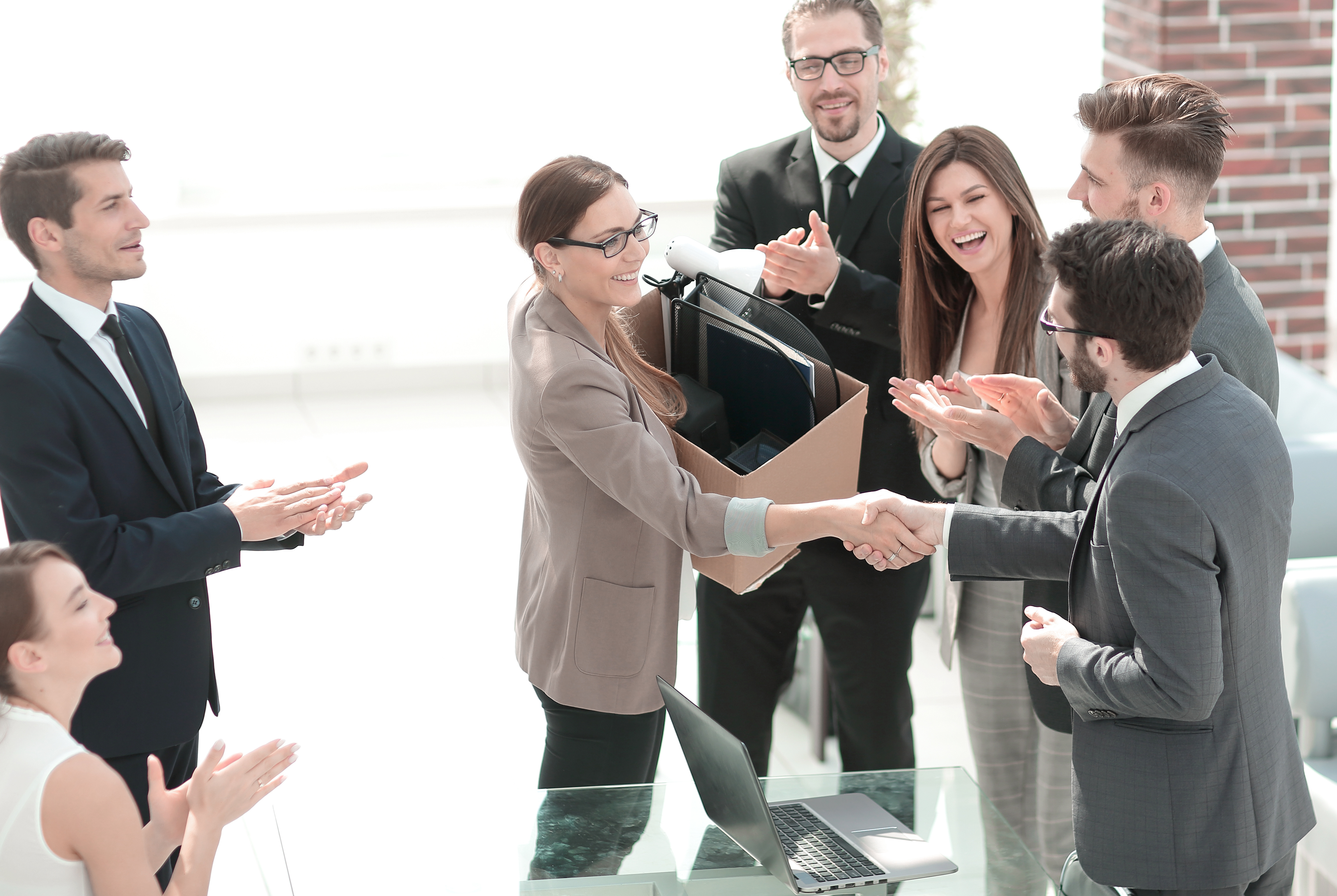 Boss shaking hands with a new employee: employee turnover