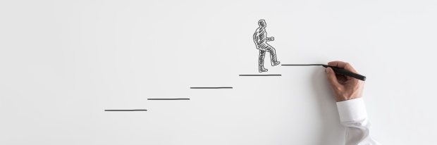 Mistakes when making a career change: Silhouetted businessman walking up the stairs towards success